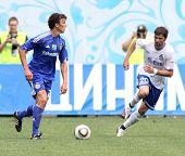 MOSCOW - JULY 3: Dynamo Kyiv's midfielder Roman Eremenko (L) and Dynamo Moscow midfielder Adrian Ropotan (R) in the VTB Lev Yashin Cup: Dynamo Moscow vs. Dynamo Kyiv, July 3, 2010 in Moscow, Russia.