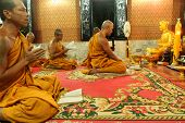 KOH CHANG, THAILAND - DECEMBER 5: Recitation of mantras by monks in a Buddhist monastery Wat Klong P