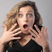 Young woman with surprised expression