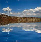 Modern white wind turbine or wind mill producing energy