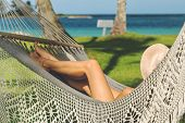 Beautiful Woman Relaxing In Hammock On The Beach. Healthy People Lifestyle. Woman Relaxing On The Be poster