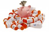 pic of stimulation  - A pink piggy bank stuffed with money sitting atop a pile of medicine bottles - JPG