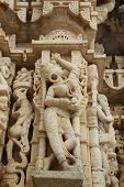 pic of jain  - Detail of a woman with earrings on a pillar in Chaumukha Mandir the main jain temple at Ranakpur India - JPG