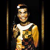 Evil Clown Holding Gun In Horror House Doorway