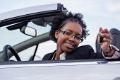 Young Black Woman Driver Holding Car Keys Driving Her New Car