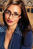 Portrait Of Young Beautiful Woman In Glasses