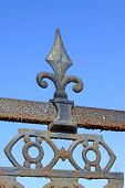 Rusty Wrought Iron In The Blue Sky