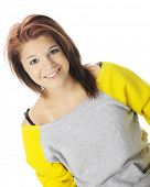 Close-up image of a beautiful teen girl in a sloppy, neon sweat shirt.  On a white background.
