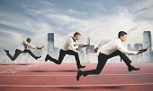 stock photo of winner man  - Competition in business concept with running businesspeople - JPG