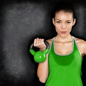 Fitness woman exercising crossfit holding kettlebell strength training biceps. Beautiful sweaty fitn
