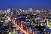 Tokyo, Japan landmark structures viewed from an Ebisu skyscraper. poster