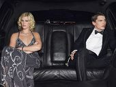 picture of breakup  - Angry young couple in limousine after breaking up - JPG