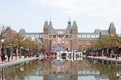 Rijksmuseum in Amsterdam with portrait of our former queen Beatrix in the Netherlands