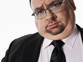 Closeup portrait of an overweight businessman against white background