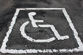Handicap parking sign on pavement