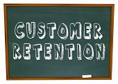 The words Customer Retention on a chalkboard for a lesson or training in keeping customers for your business
