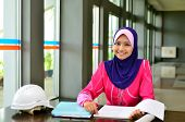 stock photo of muslimah  - Young asian muslim woman in head scarf smile - JPG