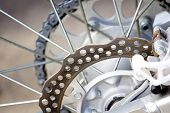 foto of motocross  - The rear brakes on a motocross bike - JPG