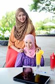 foto of muslimah  - Beautiful young asian muslim woman with smile - JPG