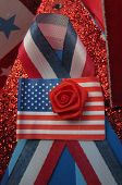Red Rose and US flag in store window display