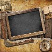 Treasure map, blackboard and old compass. Nautical still life. Adventure or discovery concept.