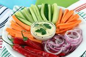 Assorted raw vegetables sticks in plate on napkins close up