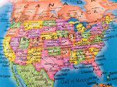 stock photo of united states map  - A macro closeup of a political globe focusing on the United States - JPG