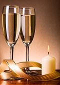 Two Glasses With Champagne And Candle