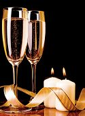 Two Glasses With Champagne And Candles