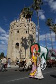 SEVILLE, SPAIN - MAY 16: The Romer�?�­ia del Roci�?�­o pilgrimage passing by the Tower of Gold