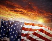 stock photo of democracy  - American flag in front of bright sky - JPG