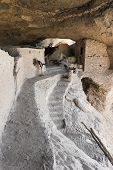 A Woman Examines Cave 4 At The Gila Cliff Dwellings