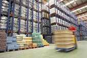 stock photo of pallet  - Blurred forklift driver warehouse - JPG