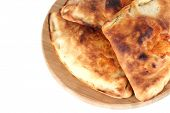 Pizza Calzones auf Holzbrett, isolated on white