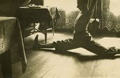 Vintage photo of man exercising a split, forties