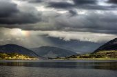 Storm clouds with rainbow over Loch Broom, Scotland