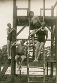 POLAND, CIRCA THIRTIES - vintage photo of four youngsters in swimming clothes, Poland, circa thirtie