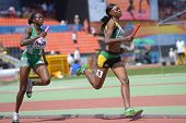 DONETSK, UKRAINE - JULY 13: Yanique McNeil, Jamaica (right) and Abimbola Junaid, Nigeria compete in