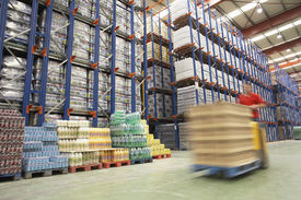 foto of forklift  - Blurred forklift driver warehouse - JPG