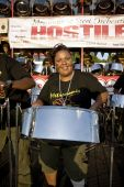 Woman playing steel drum at a festival.