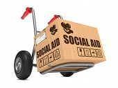 picture of hand truck  - Social Aid Slogan on Cardboard Box on Hand Truck White Background - JPG