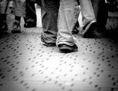 foto of big-foot  - Walking through the street crowd - JPG