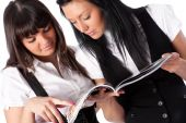 Two Young Women Reading Magazine