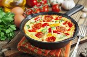 stock photo of black-cherry  - Omelet with vegetables and cheese - JPG
