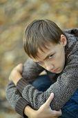 sad little boy outdoors in autumn
