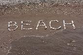 Stones Sea Background In Wet Sand Of Beach