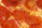 foto of pizza parlor  - Photo of Pepperoni on a Pizza - JPG