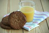 Orange Juice In Glass And Homemade Oatmeal Cookies
