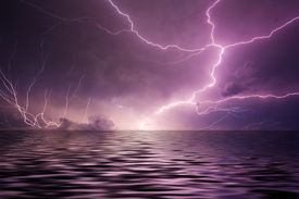 stock photo of lightning bolt  - Multiple lightning bolts reflected in the open sea - JPG