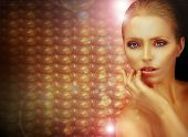Fantasy. Beautiful Woman Over Sparkling Gold Background